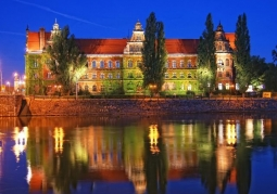 Museum by night with a reflection in Odra
